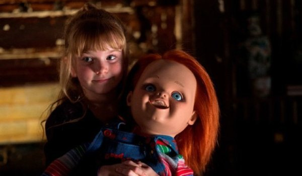 Curse of Chucky Alice holds the new Chucky doll in her arms