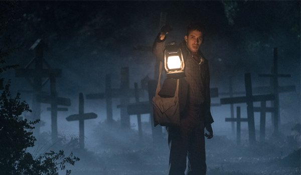 "The Nun Jonas Bloquet Maurice ""Frenchie"" Theriault holding a lantern in a graveyard"