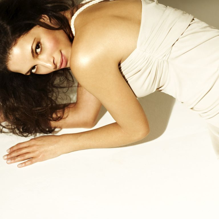 Photo of a model using a body oil