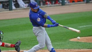 Cubs Javier Baez takes a swing at the plate.
