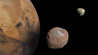 Mars and its two moons, Phobos and Deimos.