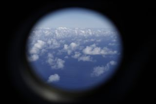 A Royal New Zealand Air Force P-3K2 Orion aircraft searches for missing Malaysian Airlines flight MH370 on March 29, 2014 over the southern Indian Ocean.