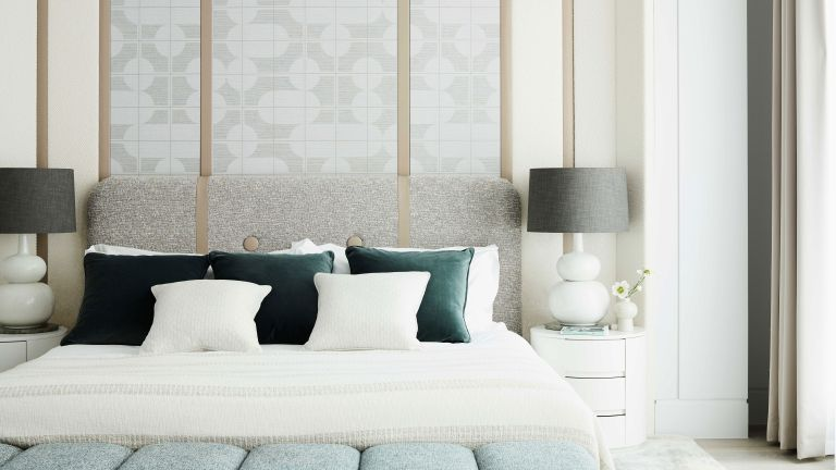 White bedroom with dark green throw cushions