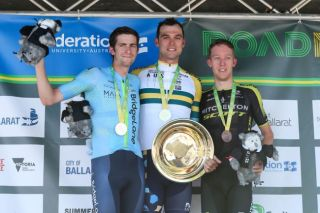 Team BridgeLane's Chris Harper (left) acknowledges the crowd support after taking second place at the 2019 Australian road race national championships