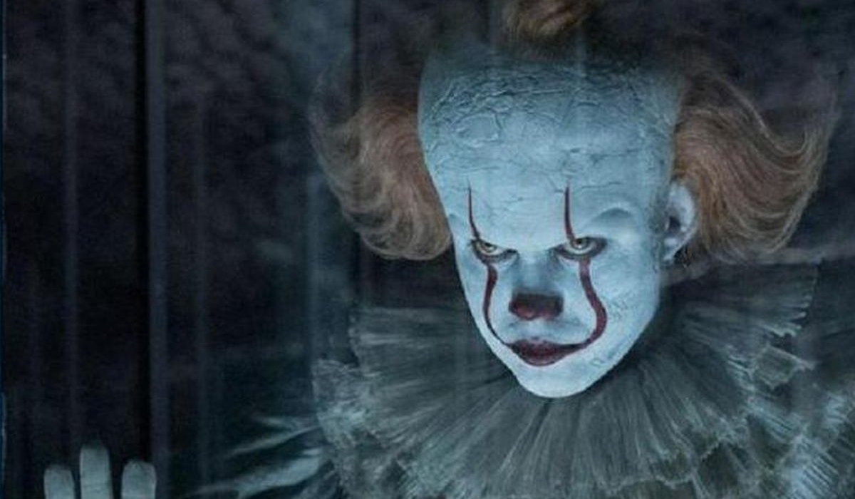 IT Chapter Two Pennywise scowling behind funhouse glass