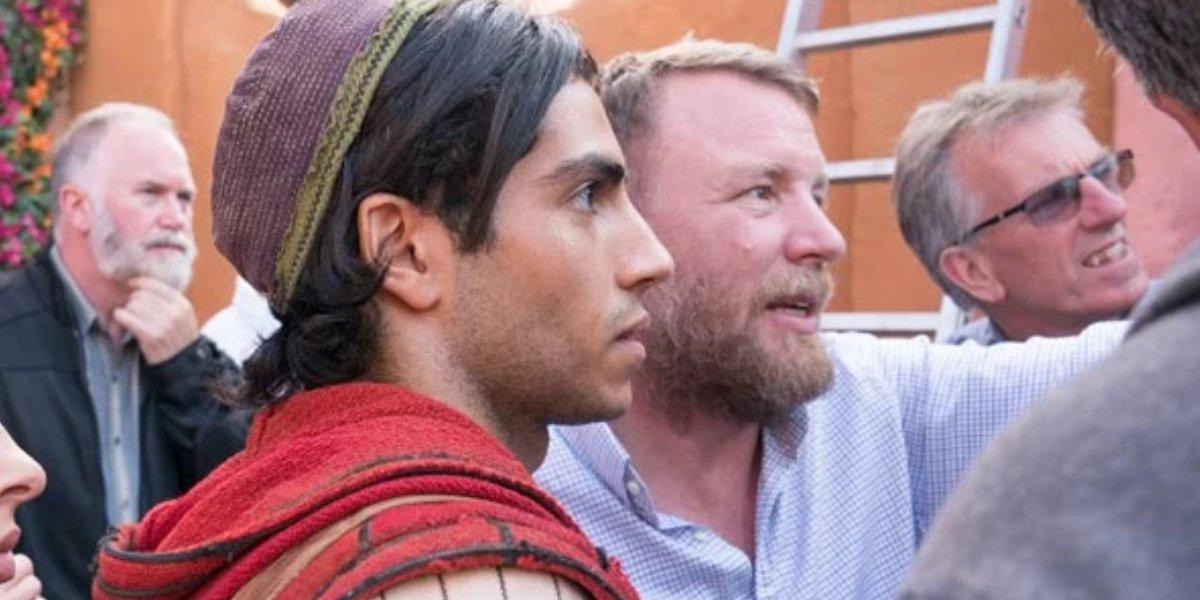 Guy Ritchie directs Mena Massoud on the set of Aladdin