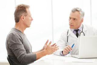 A man talks with his doctor.