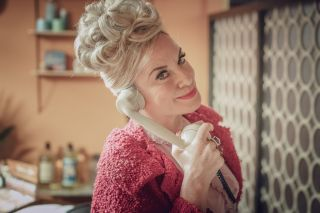 Here, with a 1960s beehive hairdo, is Tamzin Outhwaite as hair salon owner Barbara Watson in 'Ridley Road'.