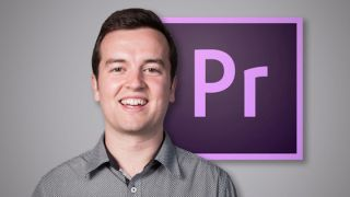 Photo of a man smiling in front of the Adobe Premier Pro CC logo