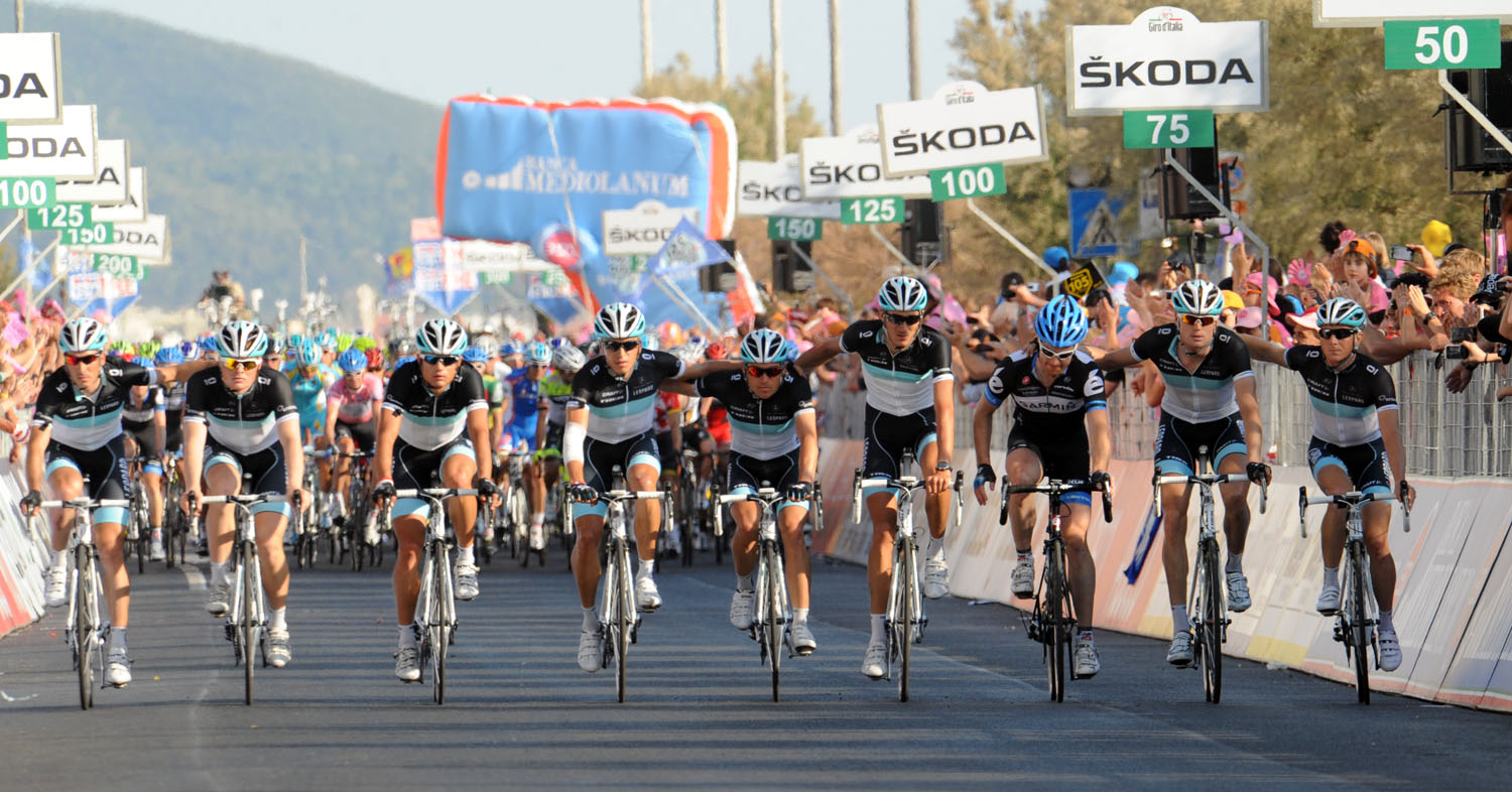 Leopard-Trek and Tyler Farrar cross the line in unison in memory of Wouter Weylandt, Giro d