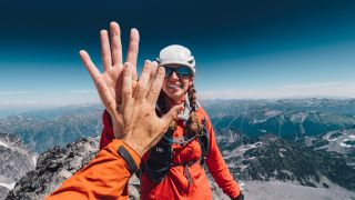 Hiking couple high fiving