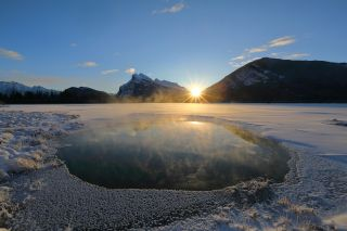 Sunrise during the winter solstice at Vermillion Lake in Banff, Canada.