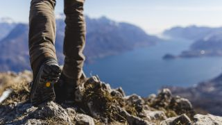 best hiking boots: hiking boot shot over Lake Como