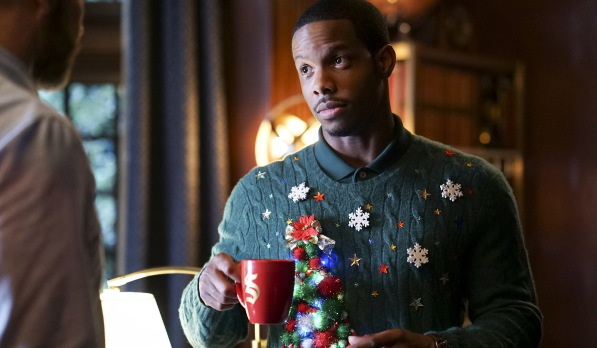 Dorian Williams in Christmas sweater Legacies Season 2