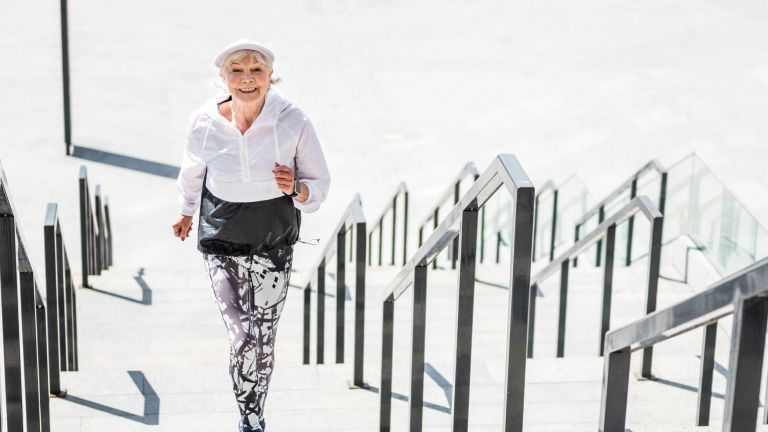 Woman running up stairs doing light-to-moderate activity