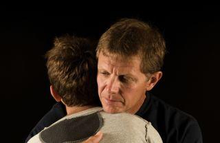 Father and son hug