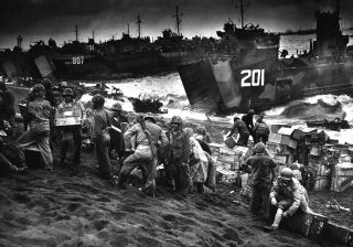 This squad of Marines, 2nd Separate Engineer Battalion, Co. B, unloads supplies on Red Beach, Iwo Jima