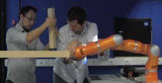 A robot helps assemble ikea furniture