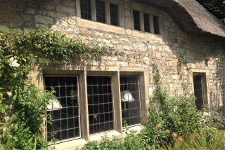 Thacthed cottage leaded light windows