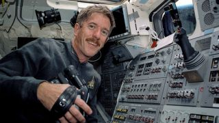 A NASA photo shows James Reilly, now the Trump-appointed director of the U.S. Geological Survey, aboard the space shuttle Atlantis in 2001. Reilly promised not to let political influences jeapordize science during his confirmation hearing in 2018.