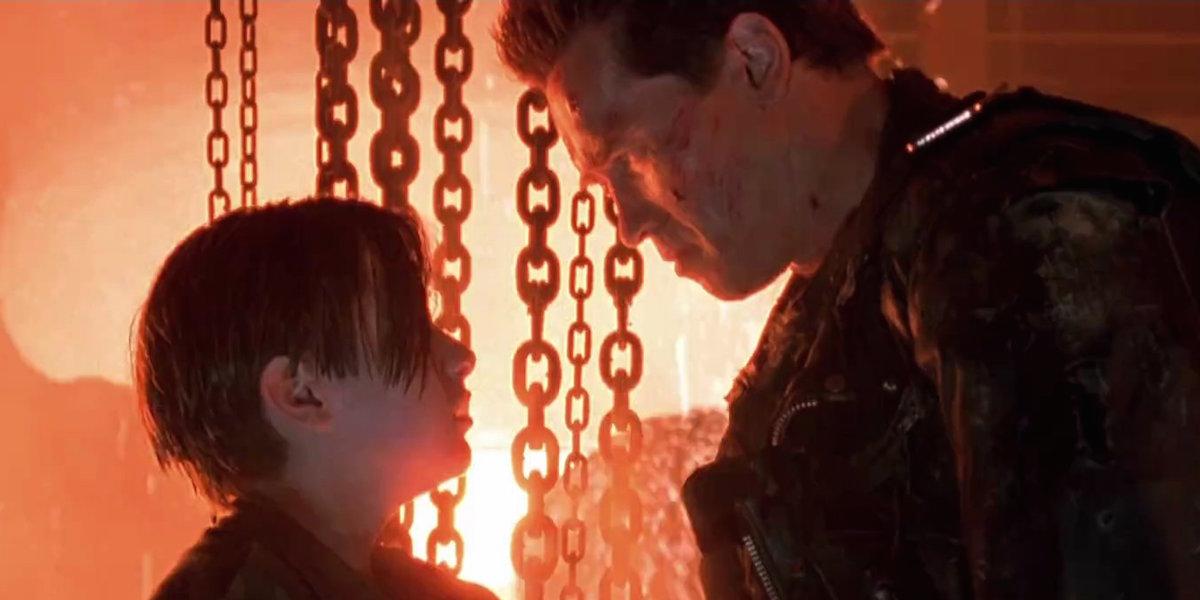 Edward Furlong and Arnold Schwarzenegger in the final scene of Terminator 2