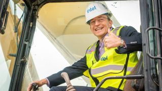 Intel CEO Pat Gelsinger signals to the crowd from earth-moving equipment in Chandler, Arizona, on Friday, Sept. 24, 2021