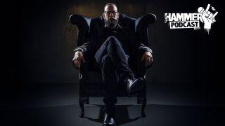 Ihsahn sitting on a chair in darkness