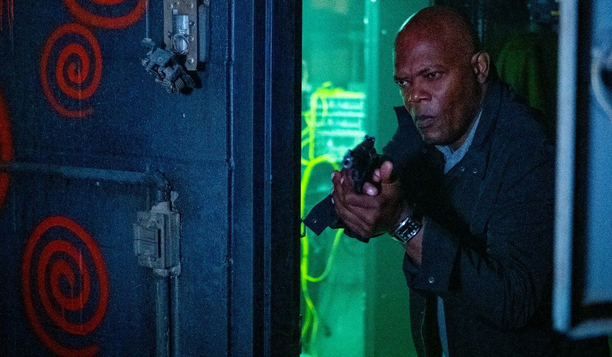 Samuel L. Jackson investigates a room, gun drawn, in Spiral: From the Book of Saw.