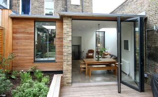 Aluminium bifold doors and casement window from IQ Glass used in extension