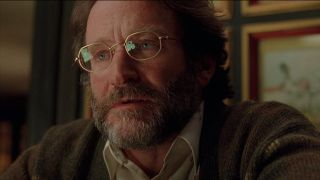 Robin Williams sits solemnly in Good Will Hunting.