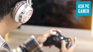 Gamer playing a game on a TV with an Xbox 360 controller and a headset on