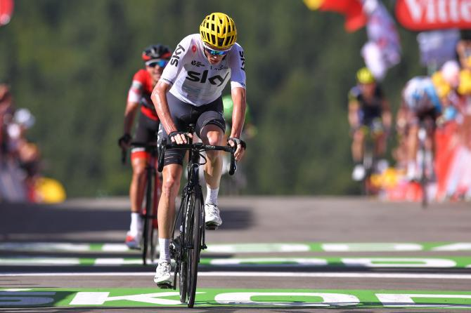 Chris Froome stops the clock with the maillot jaune