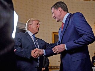 Donald Trump shaking hands with James Comey