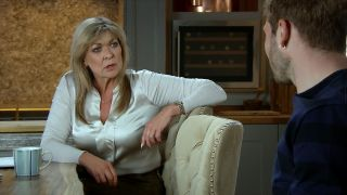 A scared Kim confides in Jamie in Emmerdale