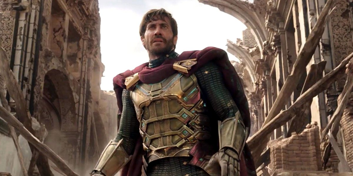 Spider-Man: Far From Home Mysterio, unmasked, stands in the ruins of an ongoing fight