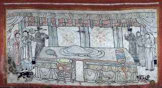 On the north wall of a 1,000-year-old tomb found recently in Datong City, in northern China, a mural shows shows a cat, dog and attendants in a bedroom with an empty bed. Exactly who occupied the tomb is a mystery -- no human remains were found.