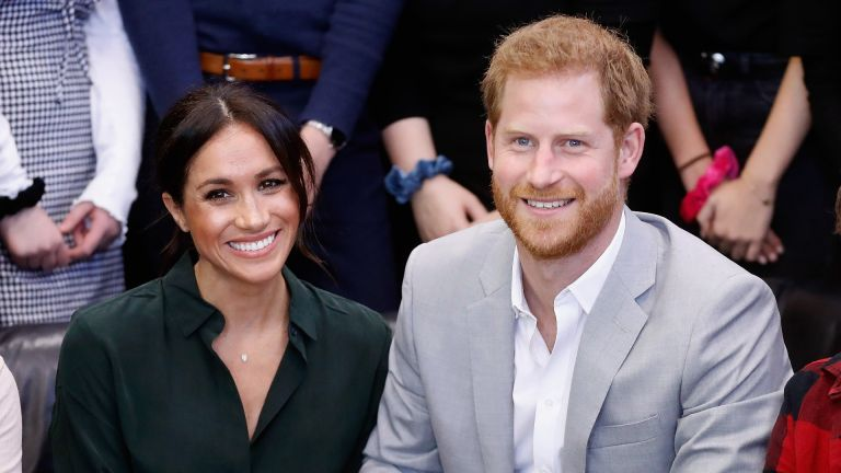 Meghan Markle and Prince Harry smile for the camera