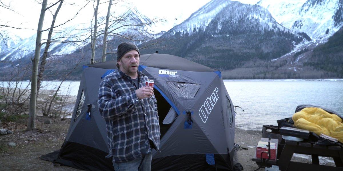 Steve Wallis camping in an ice fishing hut