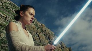 "Rey, played by Daisy Ridley, trains in the ways of the Force in ""Star Wars: The Last Jedi."""