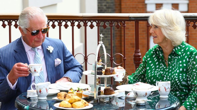 Charles and Camilla eating afternoon tea