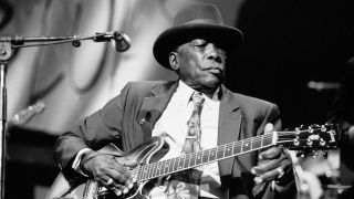 John Lee Hooker playing guitar