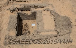 A cemetery containing at least 15 burials was found beside the remains of the ancient Abydos city. One of the tombs (shown here) holds the remains of at least one person in a fetal position. The grave would have been covered with a building (remains shown