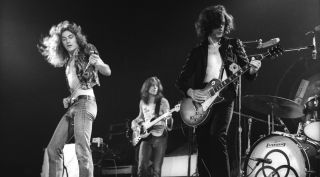 (left to right) Led Zeppelin's Robert Plant, John Paul Jones and Jimmy Page perform live at The Forum in Los Angeles on June 3, 1973