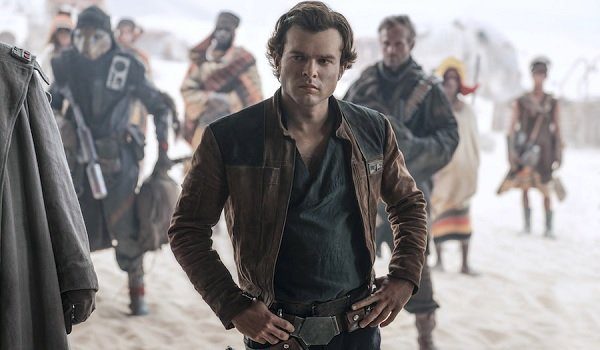 Solo: A Star Wars Story Han stands arms akimbo, listening to the plan
