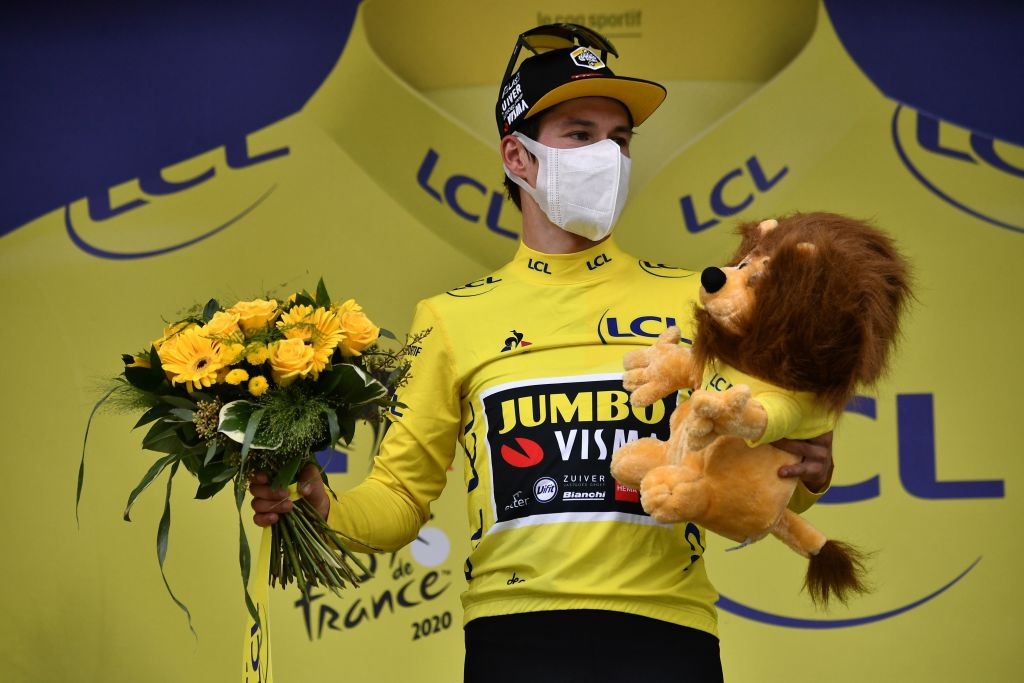 Team Jumbo rider Slovenias Primoz Roglic celebrates his overall leader yellow jersey on the podium at the end of the 9th stage of the 107th edition of the Tour de France cycling race 154 km between Pau and Laruns on September 6 2020 Photo by Marco Bertorello POOL AFP Photo by MARCO BERTORELLOPOOLAFP via Getty Images