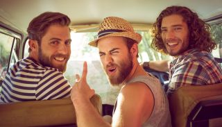 Three white hipster dudes in a van, ready to get lit.