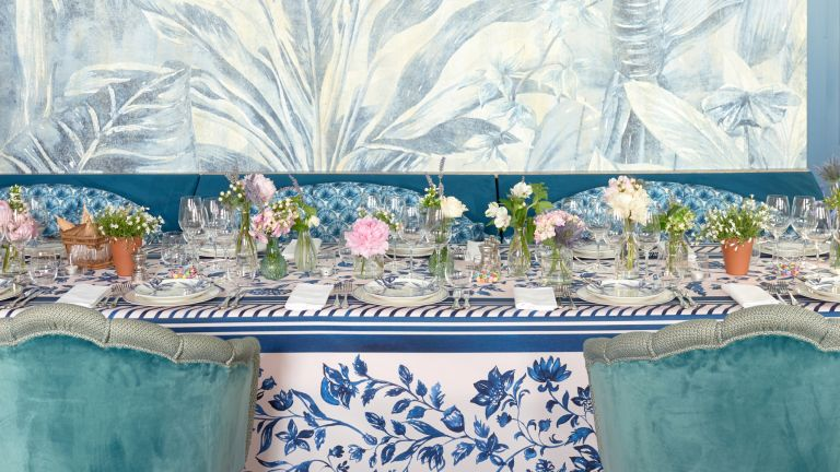 Water color wallpaper above dining table in Café Lapérouse