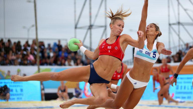 Martinsen Marielle Elisabeth Mathisen (l) of Norway plays a shot during 2018 Women's Beach Handball World Cup final against Kaloidi Anna Polyxeni of Greece on July 29, 2018 in Kazan, Russia.