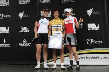 Giorgia Bronzini flanked by Annette Edmondson and Tiffany Cromwell on the women's podium.