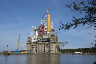 The core stage of NASA's first Space Launch System rocket, as seen on the test stand in Mississippi earlier this year.